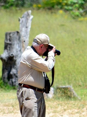 George Pond photographing birds
